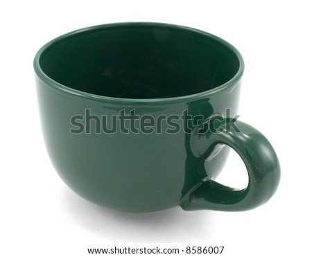 Green coffee mug isolated on white background.