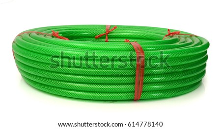 Green coiled rubber hose isolated on white