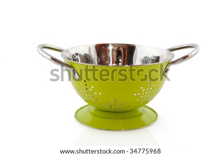 Green colander as kitchen equipment isolated over white