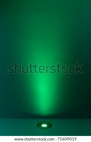 Green color background with lighting bulb and blank space for text or object