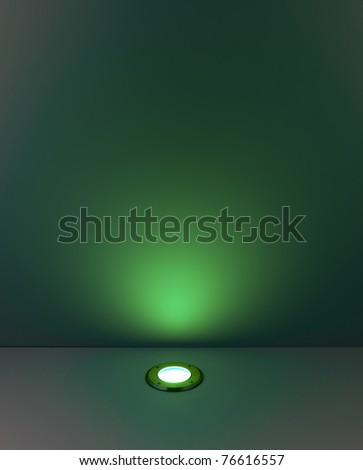 Green color background with lighting bulb and blank space for text or object - stock photo