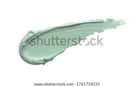 Green color correcting concealer smear smudge isolated on white background. Thick cream texture. Facial mask, skincare beauty product swatch closeup Stock photo ©