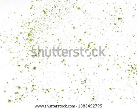 Green color of Japanese green tea powder are splashed on white paper. #1383452795
