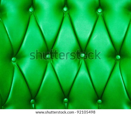 Green color of upholstery leather pattern as background - stock photo