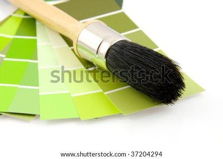 Green color samples and paint brush isolated on white background