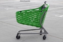 Green color shopping cart for shopping in supermarket, hypermarket, store