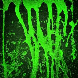 Green color splash on black background, Grunge background.