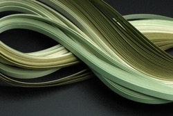 Green color strip wave paper. Abstract texture black background.