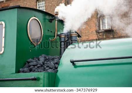green color train detail at cabin and steam