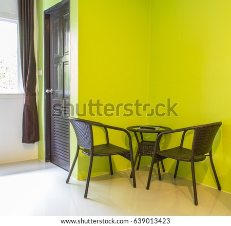 green color wall in modern room of hotel #639013423