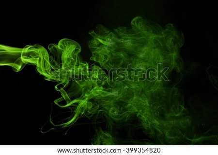 Green colored smoke on a black background, abstract cloud.  Abstract green lighting,