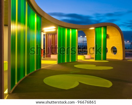 Green colored waiting area of a bus station