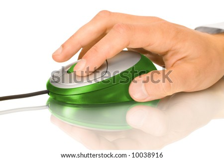 Green computer mouse and hand with reflection