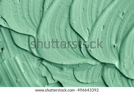 Green cosmetic clay texture close up