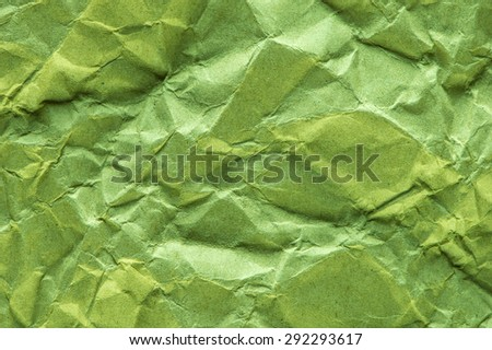 Green crepe paper background abstract.