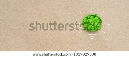 Green crumpled paper light bulb, Corporate Social Responsibility (CSR), eco-friendly business and environmental concept with copy space