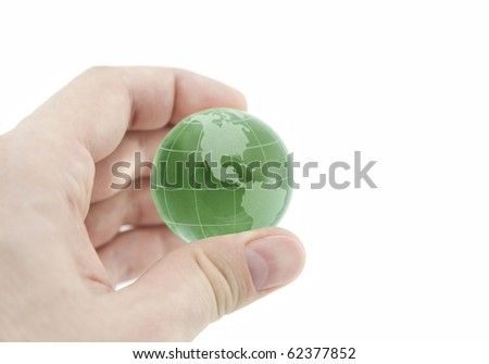 Green crystal globe in hand with clipping path