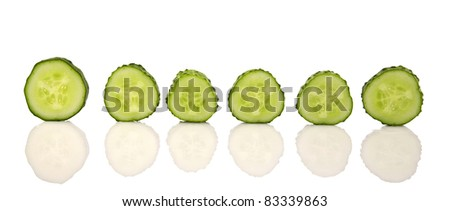 Green Cucumber sliced on a white background