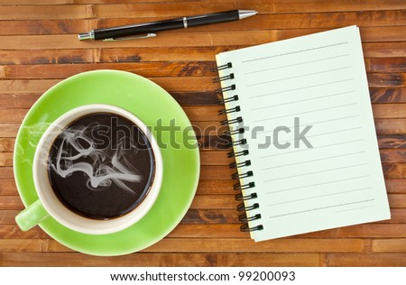 green cup coffee and note paper on wood background