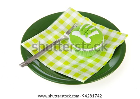 Green cupcake for St. Patrick's day with fork