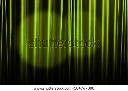 Green curtain background.