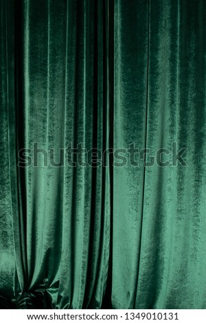 Green curtain of luxurious velvet on the theater stage. Copy space. The concept of music and theatrical art. #1349010131