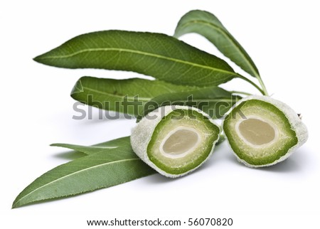 Green cut almond with its leaves.