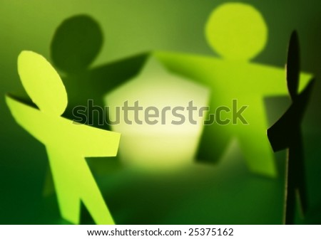 green cutouts of paper people