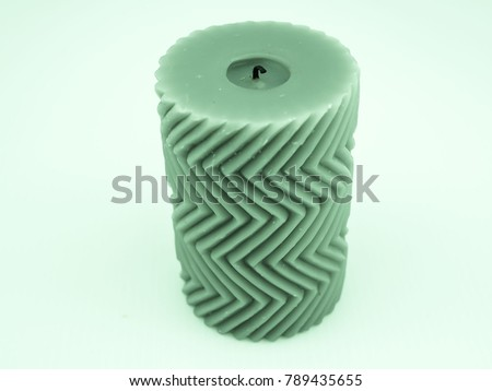 Green decorated candle with zigzag pattern #789435655