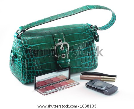 Green designer bag with mobile phone and cosmetics