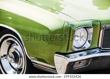 green detail on the headlight of a vintage car