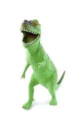 green dinosaur play toy isolated on white background