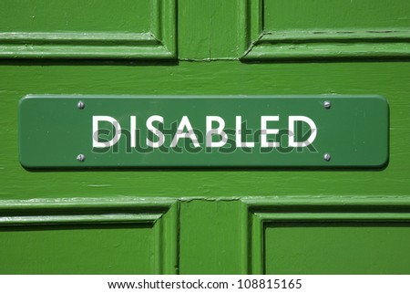 Green Disabled Sign on Door