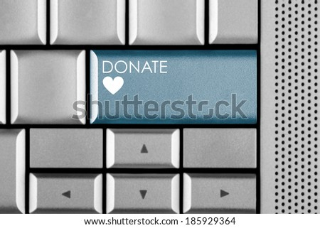 Green Donate key on a computer keyboard with clipping path around the Donate key