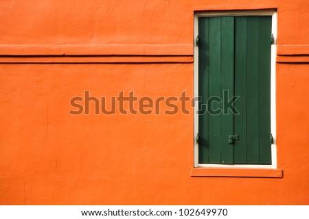 Green door and orange wall