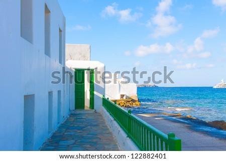 Green Door by sea shore Mykonos Island Greece Cyclades