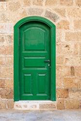 Green door in an old building