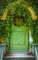 Green Door Of Fairytale Cottage With Round Window