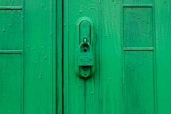Green door with lock