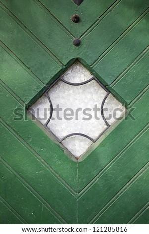 Green door with window, door detail classical in the city - stock photo