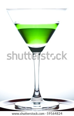 Green drinks in martini glass on white background - stock photo