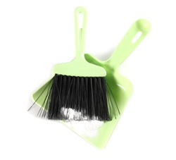 Green dustpan with bristle, broom sweeper isolated on white background, top view