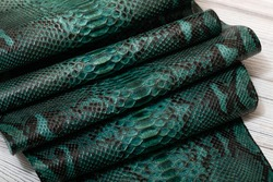 Green dyed python leather with snake black print