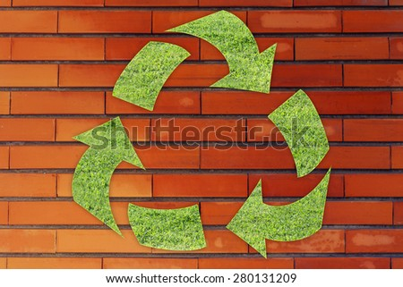 green economy and ecology: symbol of recycling made of grass