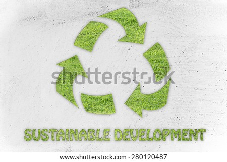green economy and ecology: symbol of recycling made of grass with writing Sustainable development