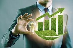 Green economy growth concept with businessman