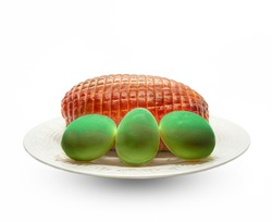 Green Eggs and Ham on a white plate and white background