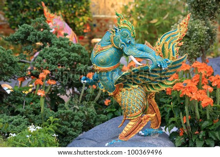 Green elephant statue with wings standing on artificial rock with plant gardening at Royal funeral pyre for cremation ceremony of the HRH Princess Bejaratana Rajasuda at Sanam Luang in Bangkok