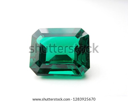 green emerald cut gem isolated on white background for gems jewelry #1283925670