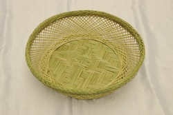 Green empty handmade bamboo basket isolated. Bread storage container